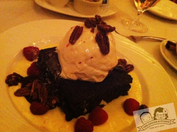Flaming Chambord Brownie with raspberries and candied pecans